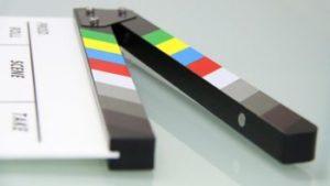 Un ciak per rappresentare la produzione al Cineporto.